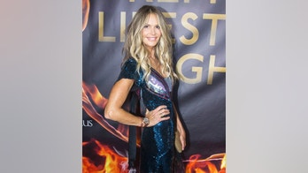 54-year-old blonde beauty Elle Macpherson poses on the red carpet with Marcel Remus on 'Remus Lifestyle Night', held at Llaut Palace Hotel in Palma de Mallorca, Spain. August 2, 2018 X17online.com USA ONLY