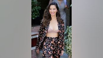 Actress Olivia Munn dons a floral suit and lilac bra as she attends the 'Predator' photocall at Villamagna hotel in  Madrid, Spain. September 4, 2018 X17online.com USA ONLY