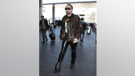 Nicolas Cage leaving LAX with cool leopard jacket sept 18, 2018  /X17online.com