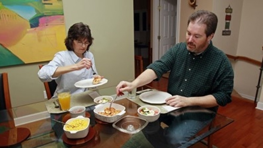 In this Friday, Jan. 14, 2011 photo, Beverly and Eugene Murray have dinner at their home in Cary, N.C. As the economy improves and families have more spending money, they're still saving restaurants for special occasions. (AP Photo/Gerry Broome)