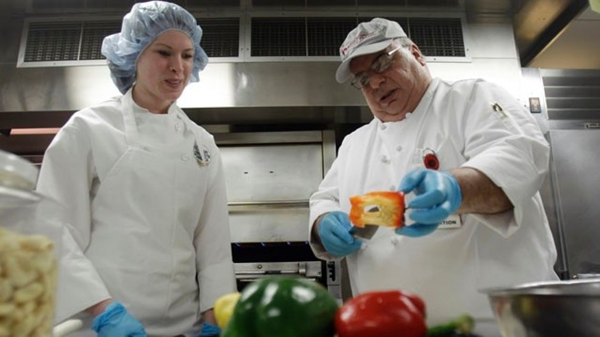 This Tuesday, Feb. 15, 2011 photo shows Megan Eckhardt, left, a student at the Culinary Institute of America, as she works with Anthony Fischetti, executive chef at Vassar Brothers Medical Center, in the kitchen of the hospital in Poughkeepsie, N.Y. The Culinary Institute of America, the well-known school for chefs north of New York City, is now offering a first-of-its-kind course on cooking for health care patients. Students in the elective class take field trips to nearby Vassar Brothers Medical Center and to Memorial Sloan-Kettering Cancer Center in Manhattan.     (AP Photo/Mike Groll)