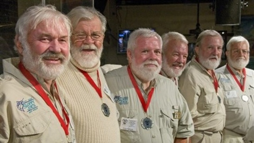 "In this photo, released by the Florida Keys News Bureau, some of the semi-finalists of the 2011 ""Papa"" Hemingway Look-Alike Contest including, from left, Arnie Inge-Mathisen, Bear Hoochuck, Greg Fawcett, Charlie Boice, Ed Lindoo and Frank Long show their to looks to the audience during the first of two preliminary rounds Thursday, July 21, 2011, at Sloppy Joe's Bar in Key West, Fla. More than 120 men resembling Ernest Hemingway are entered into the contest that is a facet of Key West's annual Hemingway Days festival. The finals are set for Saturday, July 23."
