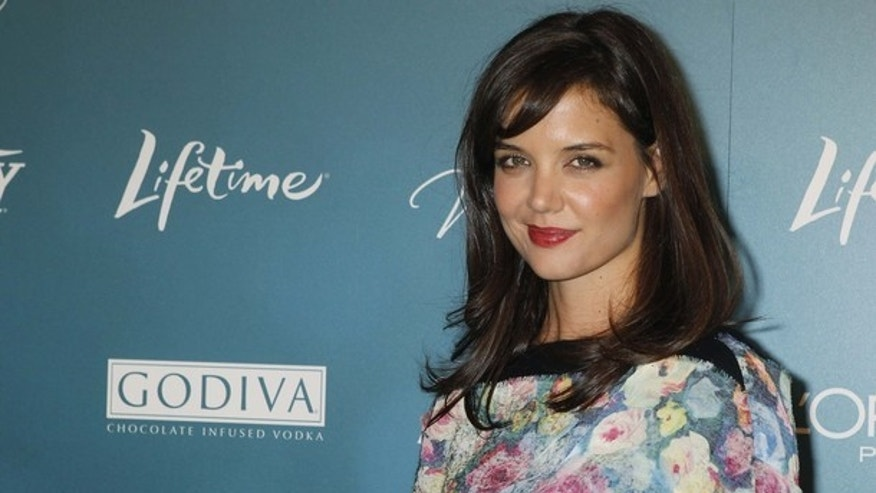 Actress Katie Holmes arrives at Variety's second annual Power of Women Luncheon in Beverly Hills September 30, 2010. The event celebrates women in entertainment who have made significant contributions to charitable causes. Holmes was honored for her work with the Dizzy Feet Foundation. REUTERS/Fred Prouser   (UNITED STATES - Tags: ENTERTAINMENT)