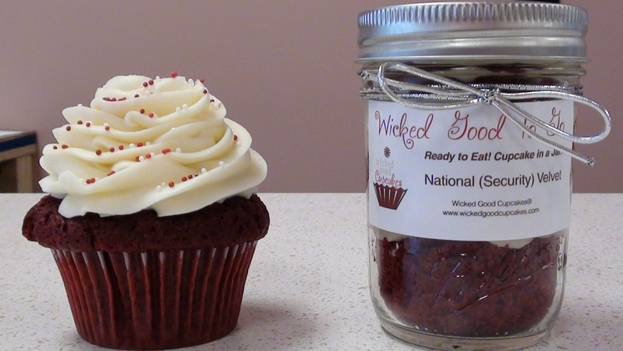 A red velvet cupcake along with the newly minted National (Security) Velvet from Wicked Good Cupcakes.