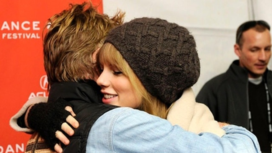 Singer Taylor Swift gets a hug from Robert Redford at the premiere of the documentary film at the 2012 Sundance Film Festival in Park City, Utah, Friday, Jan. 20, 2012.