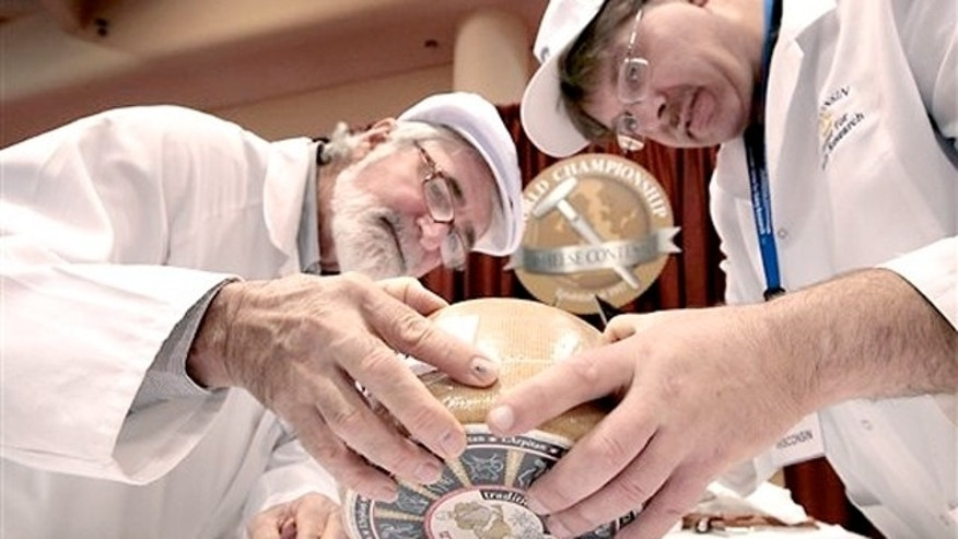 March 5, 2012: Russell Smith of Australia, left, and John Jaeggi of Madison prepare to sample one of the entries in the Smear Ripened Semi-soft Cheese category.