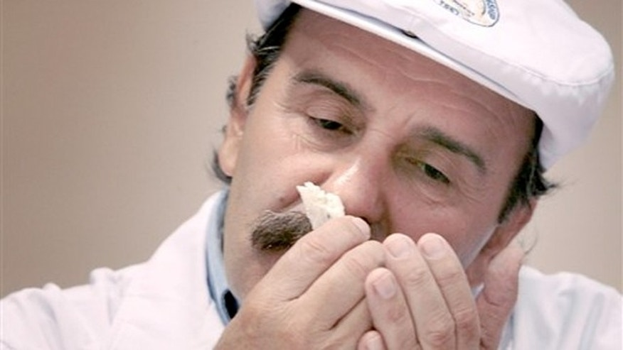March 5, 2012: Judge Roberto Castenega of Argentina, samples the aroma of one of the entries in the Semi-soft Goat's Milk Cheese category during the opening day of the World Championship Cheese Contest at the Monona Terrace Convention Center in Madison, Wis.