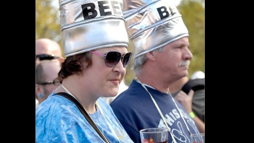 Sept. 17, 2011: AAmber Hill, left, and her father, Howard Hill, wait to sample another beer at the annual Great Lakes Brew Fest at the Racine Zoo, in Racine, Wis.