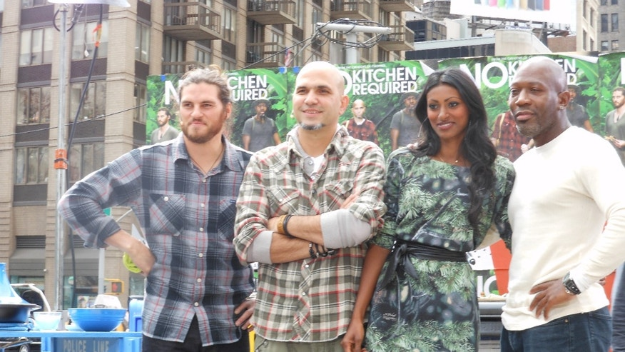 "Chef Kayne Raymond, left, Chef Michael Psilakis, Host Dr. Shini Somara and Chef Madison Cowan, right, prepare for BBC America's live ""No Kitchen Required"" New York City-inspired cooking competition."