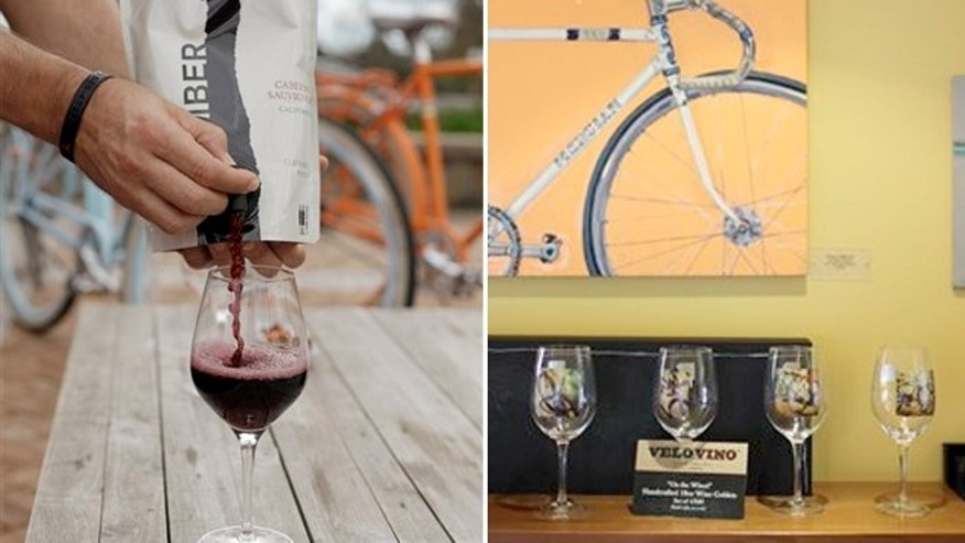 March, 21, 2012: A pouch filled with Cabernet Sauvignon wine is poured into a glass on a patio table at the Velo Vino tasting room and bike center in St. Helena, Calif.