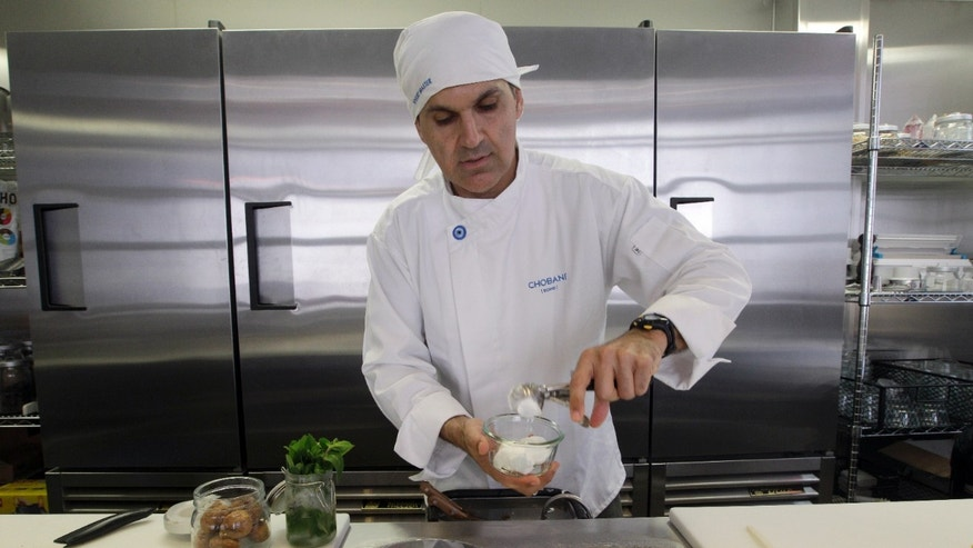 July 23, 2012: Dar Vasseghi, director of retail concepts at Chobani, prepares one of the bar's creations at the Chobani yogurt bar in the Soho neighborhood of New York.