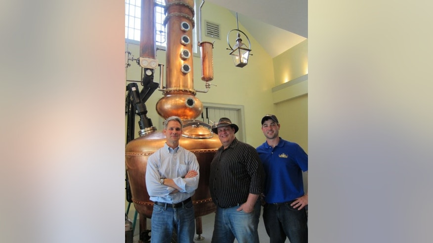Hillrock Estate Distillery's owner Jeff Baker, Master Distiller Dave Pickerell, and assistant distiller Tim Welly in front of their Kentucky-made copper still.