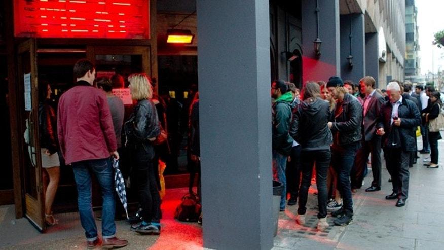 July 10, 2012: Customers form a queue as they wait to be seated in the Meat Liquor restaurant on Welbeck Street in central London.