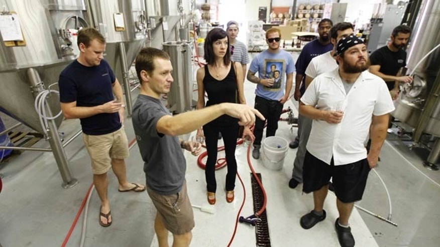 Aug. 20, 2012: Hardywood Park Craft Brewery President and co-founder, Eric McKay, second from left, and brewmaster Patrick Murtaugh, left, talk to a tour group.