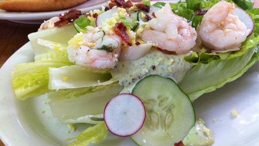 Romaine wedge salad with gulf shrimp,  radishes, bacon and green goddess dressing.