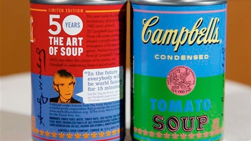 Aug. 24, 2012: A new limited edition Campbell's tomato soup cans with art and sayings by artist Andy Warhol are seen at Campbell Soup Company in Camden, N.J.