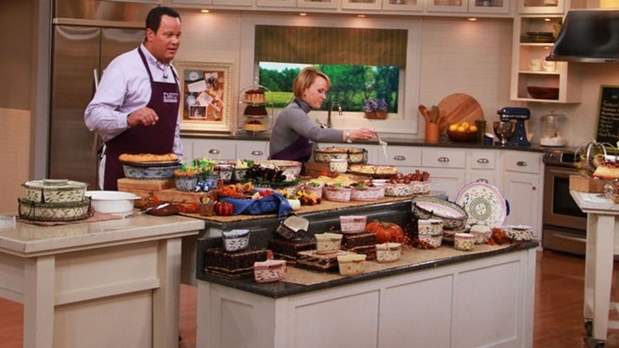 "QVC program host David Venable and Tara McConnell on set from Temp-tations during one of QVC's ""In the Kitchen with David "" broadcasts."
