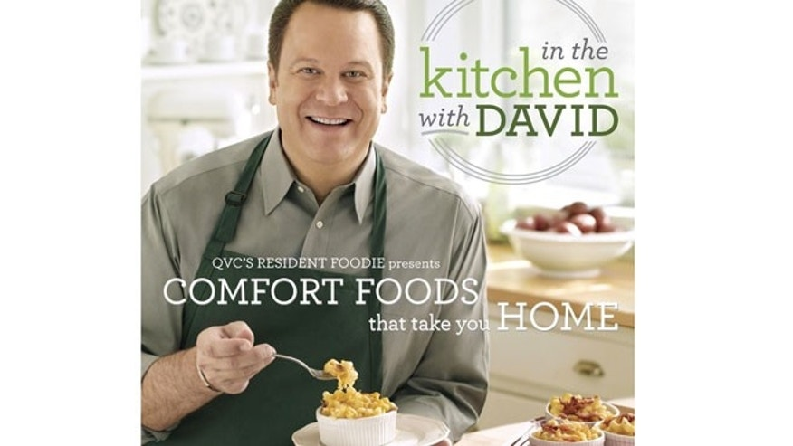 "The cover of David Venable's book, ""In the Kitchen with David."""