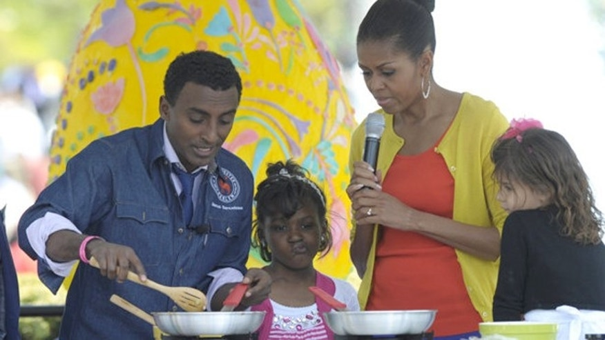 First lady Michelle Obama helps make tacos with chef Marcus Samuelsson during the annual White House Easter Egg Roll in April.