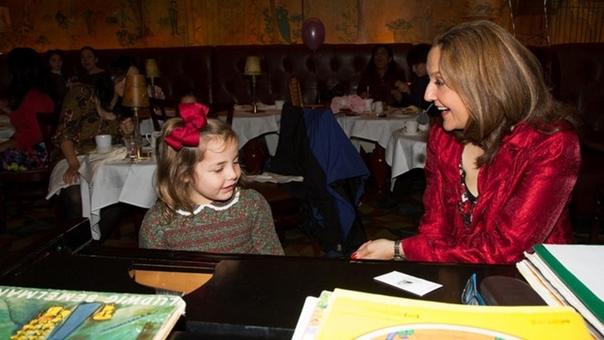 At the Madeline Tea at Bemelmans Bar inside the historic Carlyle Hotel, little customers can sing along to music performed by singer, songwriter, and jazz pianist Tina de Varon.