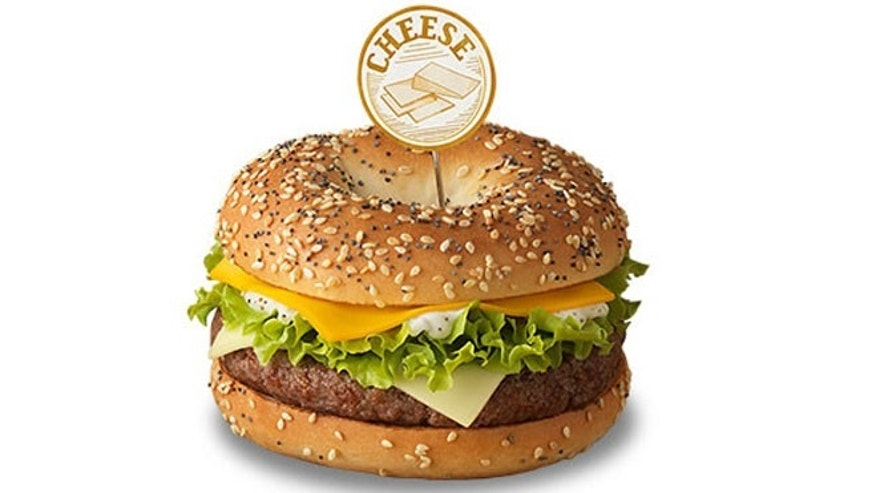 "McDonald's France's new Bagel Burgers come in three different varieties: ""Cheese,"" ""Red Onions"" and ""Bacon."""