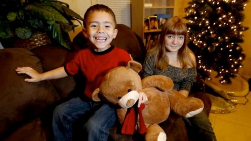 McKenna Pope, 13, right, and her brother Gavyn Boscio, 4. McKenna started a petition demanding the toy company Hasbro make its Easy-Bake Oven more boy friendly.