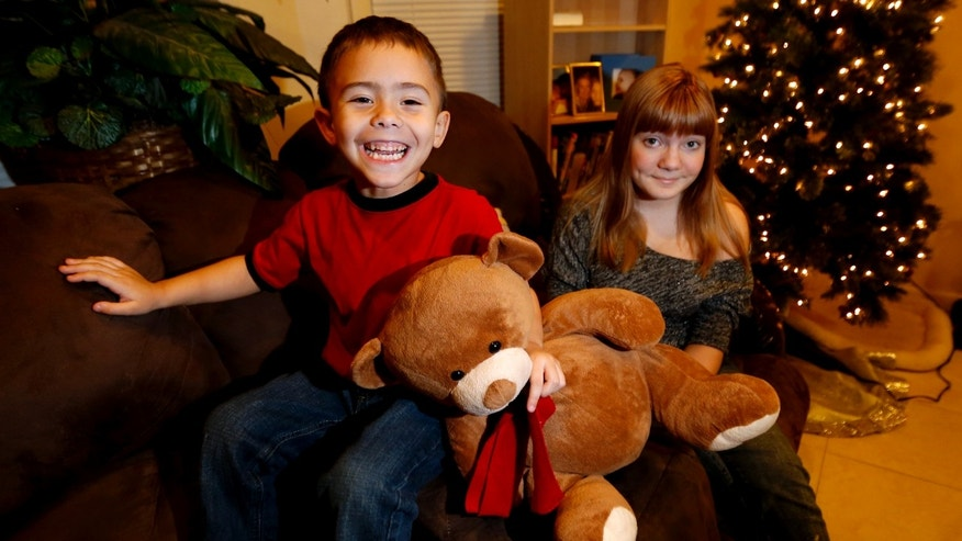 Dec. 6, 2012: McKenna Pope, 13, right, and her brother Gavyn Boscio, 4, pose for a photo at their home in Garfield, N.J.