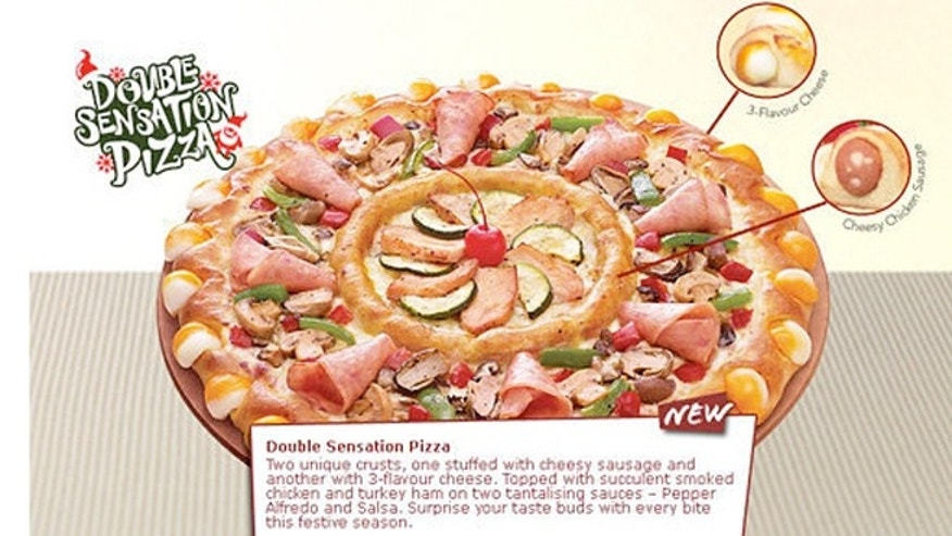 "Pizza Hut's new ""Double Sensation"" is two pies in one."