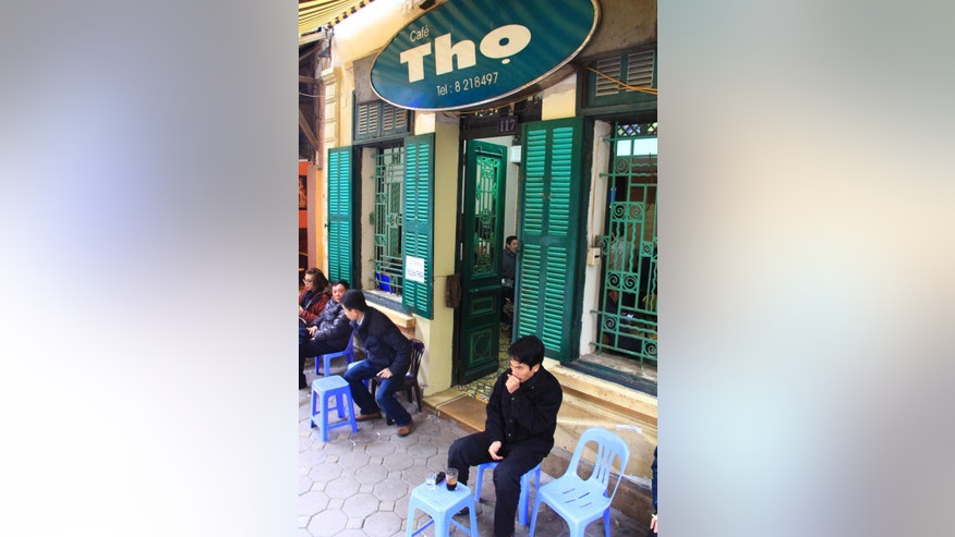 Jan. 5, 2013: A customer drinks coffee at Cafe Tho in downtown Hanoi, Vietnam.