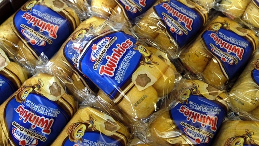 FILE - In this Friday, Nov. 16, 2013, file photo, Twinkies baked goods are displayed for sale at the Hostess Brands bakery in Denver, Colo.