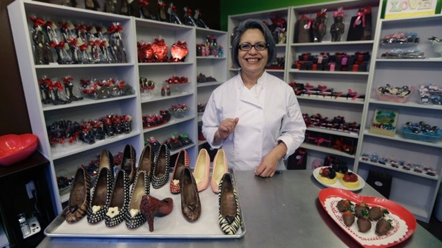 Feb. 7, 2013: Master chocolatier Andrea Pedraza shows off her chocolate shoes and other treats at her shop in the Oak Cliff section of Dallas.