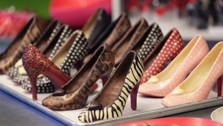 Feb. 7, 2013: Chocolate high heals made by master chocolatier Andrea Pedraza are lined up at her shop in the Oak Cliff section of Dallas.