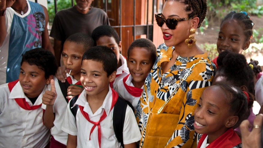 April 4, 2013: U.S. singer Beyonce poses for photos with school children as she tours Old Havana, Cuba. Beyonce is in Havana with her husband, rapper Jay-Z, on their fifth wedding anniversary.