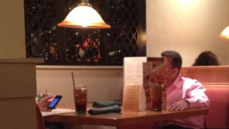 Diner Adam Howell captured this image of a feuding couple at a North Carolina Olive Garden that has since gone viral.