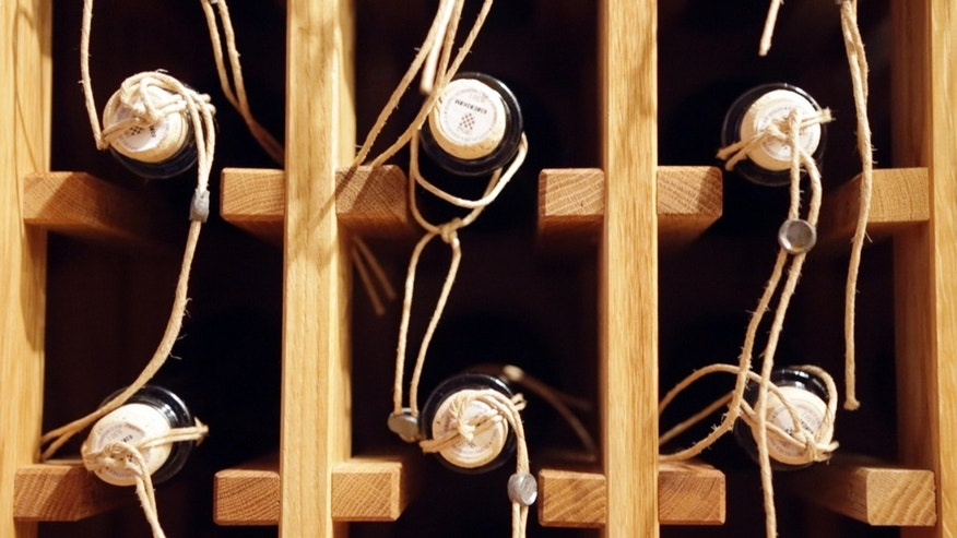 April 27, 2013: Bbottles of local made sweet wine Prosek are seen on a shelf in a wine cellar in Jelsa, southern Croatia.