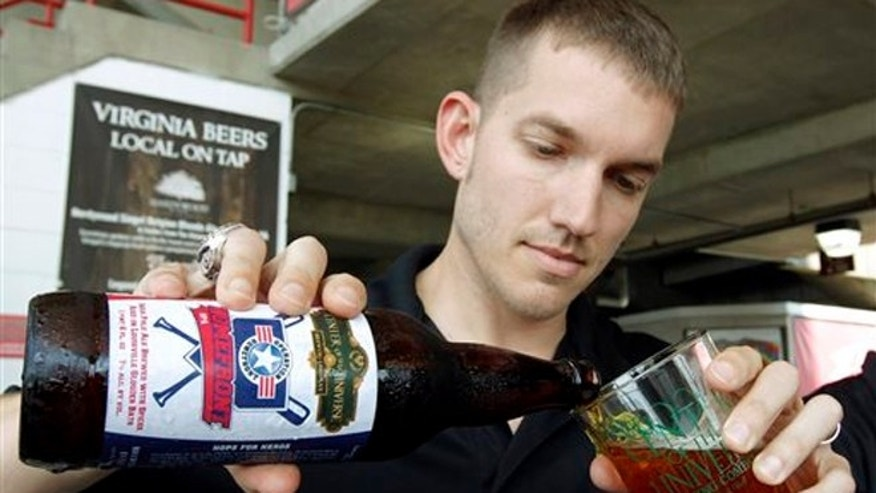 May 22, 2013: Former major league pitcher Chris Ray pours one of his baseball-themed beers at The Diamond in Richmond, Va.