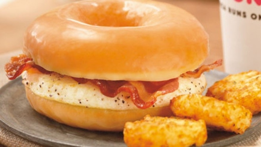 The sandwich, which comes with fried eggs and bacon between a split glazed doughnut.