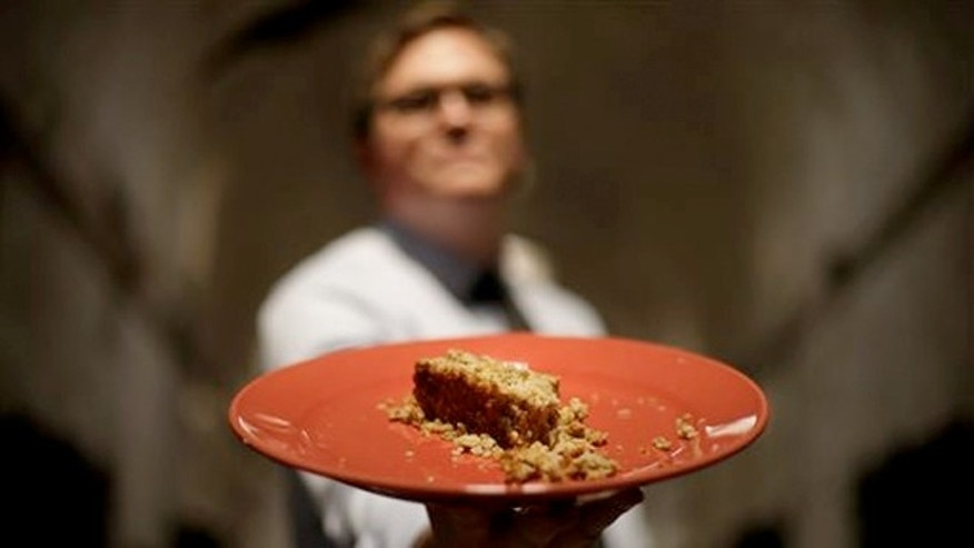 May 31, 2013 photo: Director of public programming, Sean kelly displays a plate of Nutraloaf at Eastern State Penitentiary in Philadelphia.