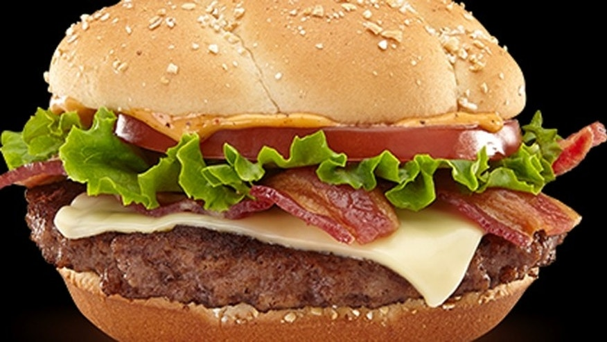 The Bacon Habanero Ranch Quarter Pounder comes topped with white cheddar, lettuce, tomato, a new habanero ranch sauce, and of course, bacon.