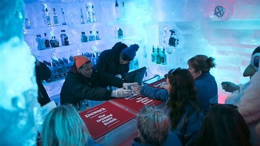 July 8, 2013: Drink mixers Udi Shakya, left, and Paul Stauros, right, serve drinks to customers at the Minus 5 ice bar.