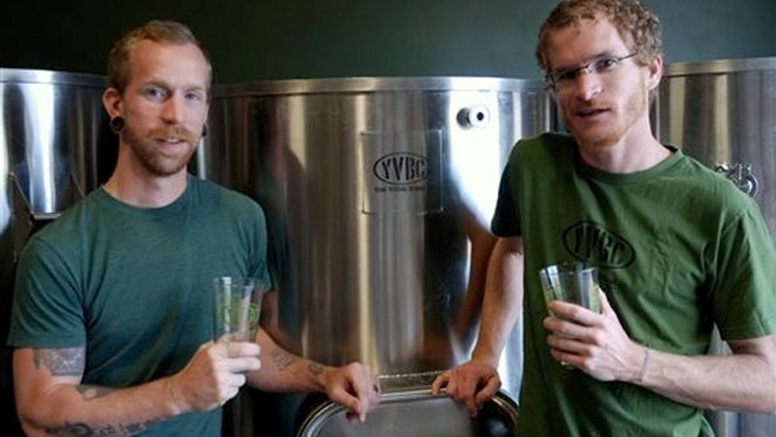 Aug. 14, 2013: Young Veterans Brewing Co. President Thomas Wilder, left, and head brewer Neil McCanon.