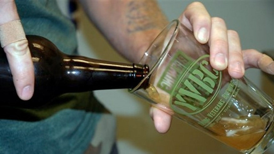 "Aug. 14, 2013: Young Veterans Brewing Co. president and Iraq War veteran Thomas Wilder pours a glass of ""Jet Noise IPA,"" at the Virginia Beach, Va., brewery."