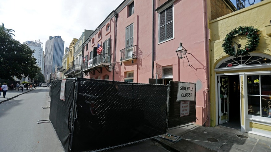 "In this photo taken on Tuesday, Nov. 12, 2013, fencing blocks the exterior of the building that used to house famed Brennan's Restaurant  in the French Quarter of New Orleans. Brennan's Restaurant: ""A New Orleans Tradition Since 1946,"" as the website brags, is closed, the latest shoe to fall in 40 years of headline-grabbing family discord and costly litigation over matters of control, money and use of the family name at some of the establishments that trace their lineage to Owen Sr. (AP Photo/Gerald Herbert)"