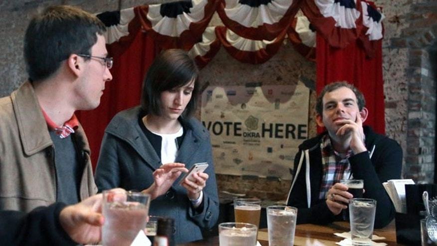 Dec. 13, 2013: In this photo, Jesse Mello, left, Erin Holt, center, and Matt Pankey enjoy drinks at The Original OKRA Charity Saloon in Houston. The gives 100 percent of its profits to charity and is set to donate more than $300,000 after its first year.