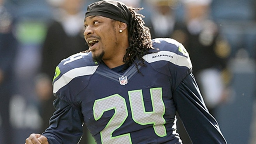Seattle Seahawk's running back Marshawn Lynch loves munching Skittles on the sidelines.