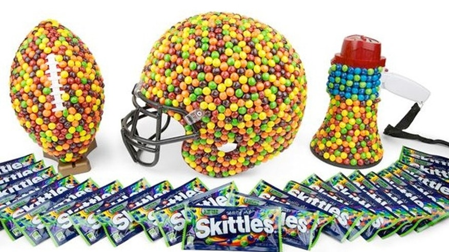 Limited-edition bags of Skittles Seattle Mix candy and football memorabilia covered in Skittles are being auctioned off online.