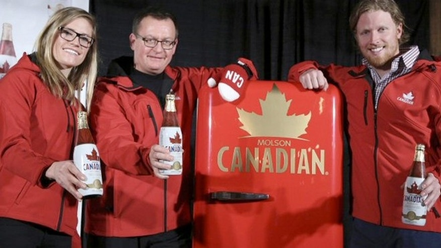 Ferg Devins of Molson Coors Canada (center) with Canadian Olympic hopefuls Georgia Simmerling (left) and Cody Sorensen.