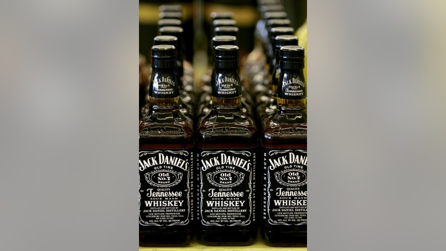 Bottles of Jack Daniel's Tennessee Whiskey are on display at a Kansas City, Mo. liquor.