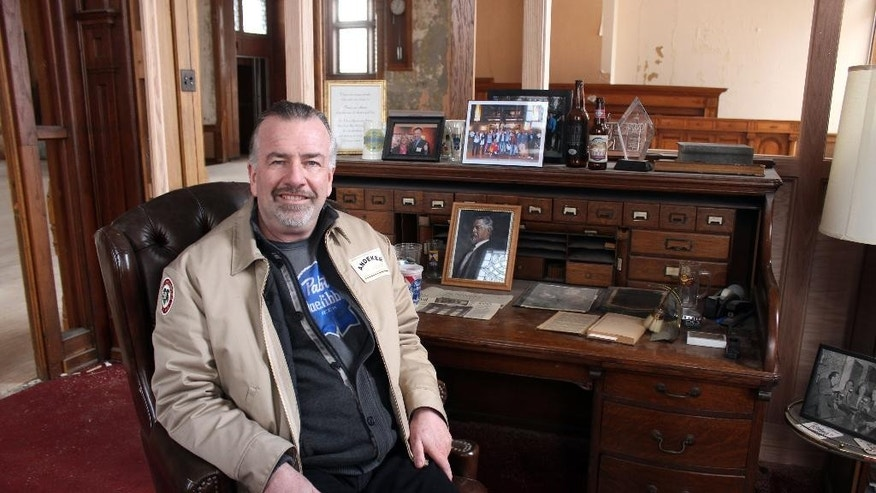 Jim Haertel sits at the desk of Frederick Pabst, who started the Pabst Brewery in 1884, in Milwaukee.