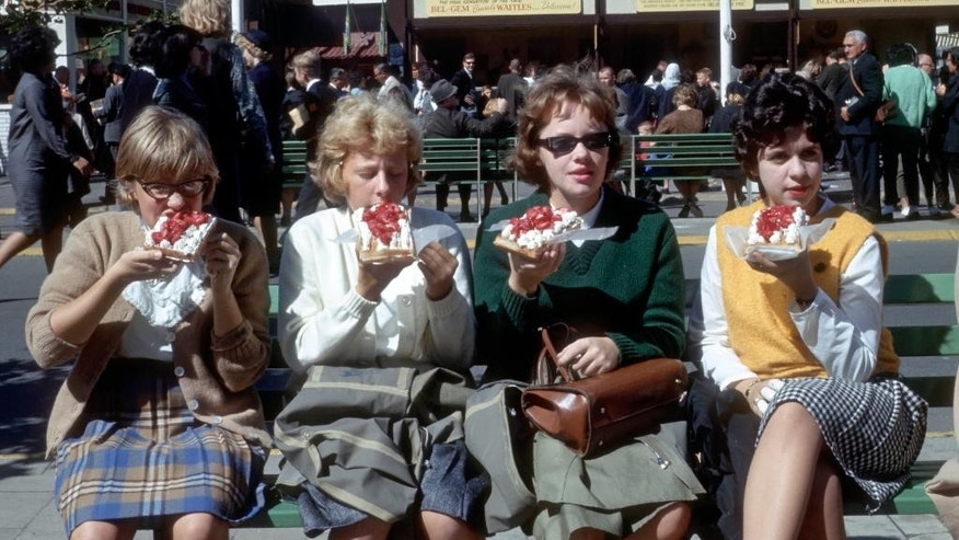 Four girls eat Belgian Waffles on the Grounds of the World's Fair in the Queens Borough of New York. Belgian Waffles were introduced to the American public at the fair by Belgian Maurice and Rose Vermersch and their daughter MariePaule.